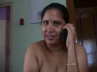 Vid gal 148. Mature indian jerking her mans cock naked while on the phone
