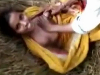 Vid gal 286. Amateur indian in open field showing her tits
