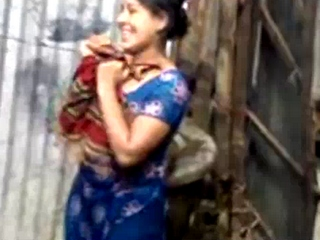 Vid gal 354. Indian village bhabhi taking open shower and drying herself off